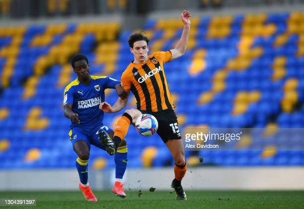 Alfie Jones of Hull City battles for possession with Paul Osew of AFC Wimbledon during the Sky Bet League One match between AFC Wimbledon and Hull...