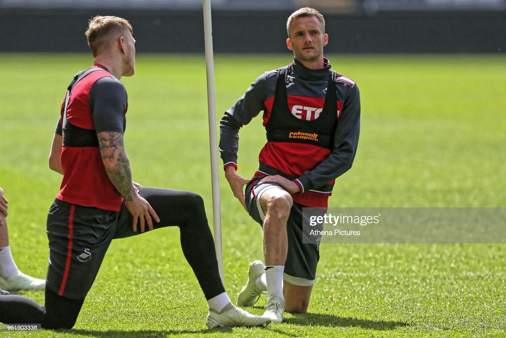 Alfie Mawson and Andy King in action during the Swansea City Training at The Liberty Stadium on April 26, 2018 in Swansea, Wales.