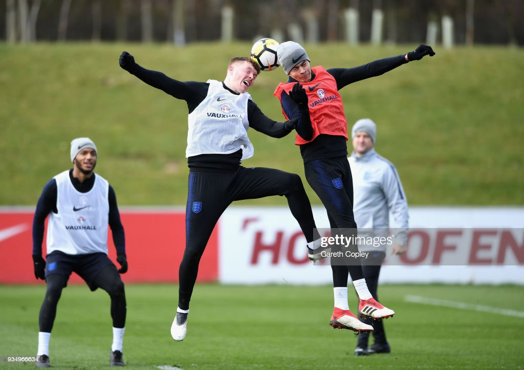 Alfie Mawson and Dele Ali trains during an England training session at St Georges Park on March 20, 2018 in Burton-upon-Trent, England.