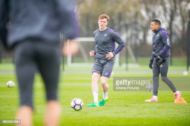 Alfie Mawson in action during the Swansea City training session at The Fairwood training Ground on March 30 2017 in Swansea Wales