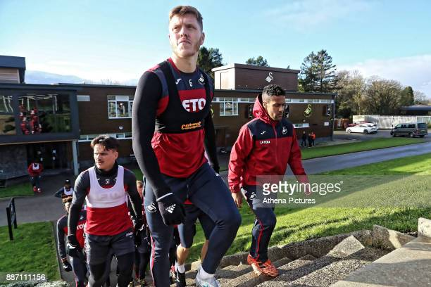 Alfie Mawson leads team mates to the training pitch during the Swansea City Training at The Fairwood Training Ground on December 05 2017 in Swansea...