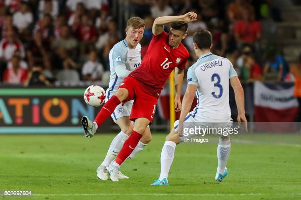 Alfie Mawson of England Ben Chilwell of England and Krzysztof Piatek of Poland battle for the ball during the UEFA European Under21 Championship...