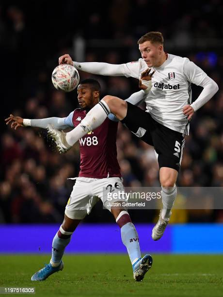Alfie Mawson of Fulham challenges Jonathan Kodjia of Aston Villa during the FA Cup Third Round match between Fulham and Aston Villa at Craven Cottage...