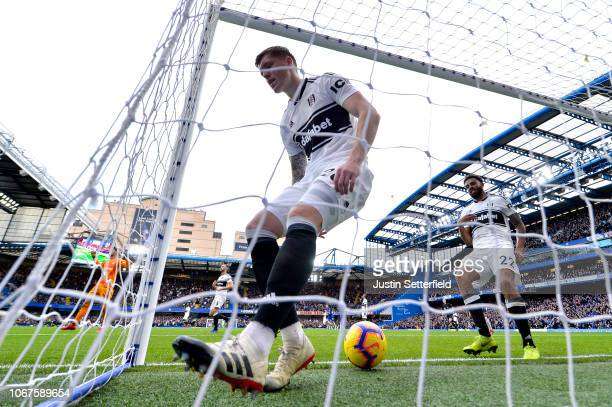 Alfie Mawson of Fulham collects the ball out of the net after Chelsea's second goal during the Premier League match between Chelsea FC and Fulham FC...
