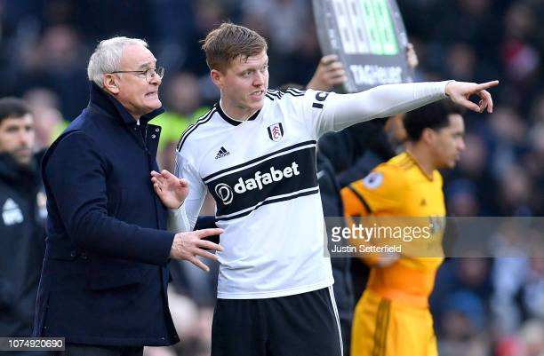 Alfie Mawson of Fulham speaks to Claudio Ranieri Manager of Fulham during the Premier League match between Fulham FC and Wolverhampton Wanderers at...