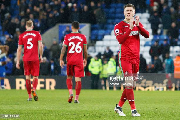 Alfie Mawson of Swansea applauds the fans after the final whistle of the Premier League match between Leicester City and Swansea City at the Liberty...