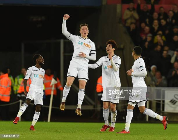Alfie Mawson of Swansea Celebrates the opener during the Premier League match between Swansea City and Liverpool at Liberty Stadium on January 22,...