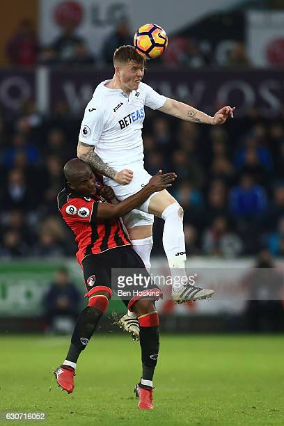 Alfie Mawson of Swansea City and Benik Afobe of AFC Bournemouth compete for the ball during the Premier League match between Swansea City and AFC...