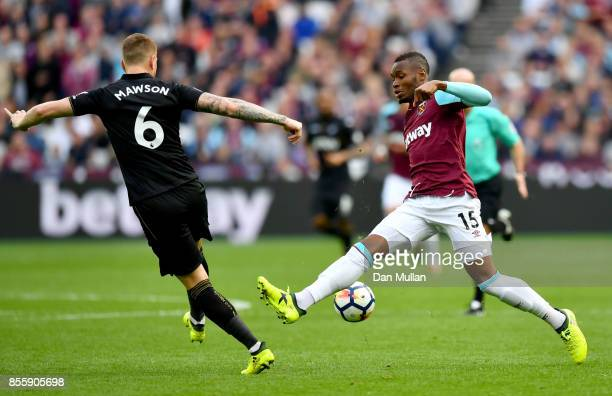 Alfie Mawson of Swansea City and Diafra Sakho of West Ham United battle for possession during the Premier League match between West Ham United and...