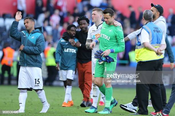 Alfie Mawson of Swansea City and Lukasz Fabianski of Swansea City dejected at full time as relegation from the Premier League is confirmed during the...