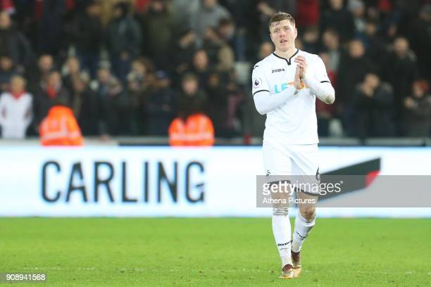 Alfie Mawson of Swansea City applauds the fans after the final whistle of the Premier League match between Swansea City and Liverpool at the Liberty...
