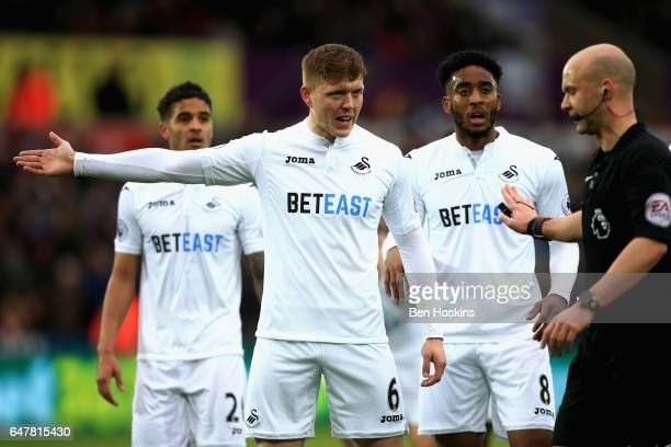 Alfie Mawson of Swansea City argues with the referee during the Premier League match between Swansea City and Burnley at Liberty Stadium on March 4...