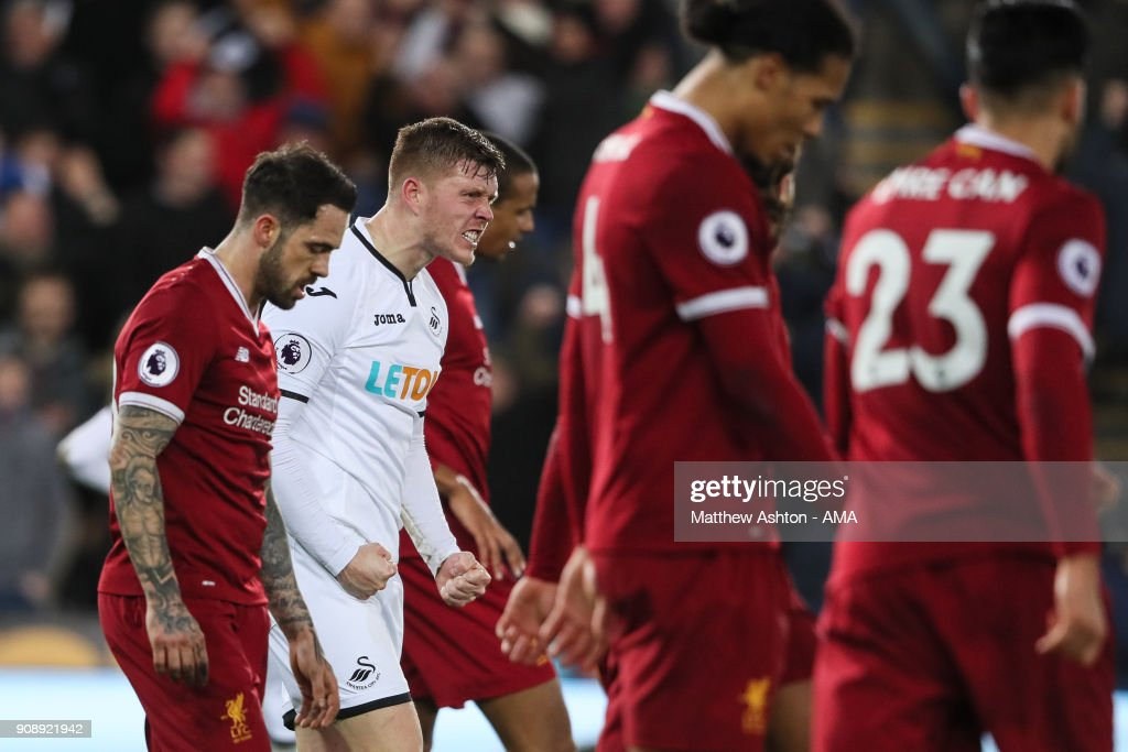 Alfie Mawson of Swansea City celebrates at full time during the Premier League match between Swansea City and Liverpool at Liberty Stadium on January 22, 2018 in Swansea, Wales.