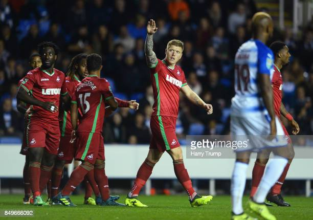 Alfie Mawson of Swansea City celebrates scoring his sides first goal during the Carabao Cup Third Round match between Reading and Swansea City at...