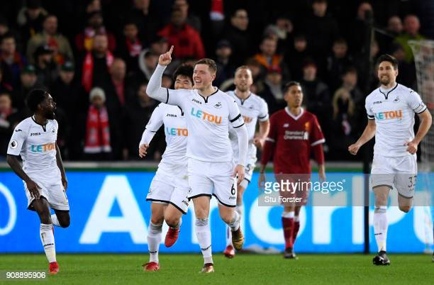 Alfie Mawson of Swansea City celebrates scoring his side's first goal during the Premier League match between Swansea City and Liverpool at Liberty...