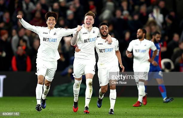 Alfie Mawson of Swansea City celebrates scoring the opening goal with his team mates Ki Sung-Yueng and Neil Taylor during the Premier League match...