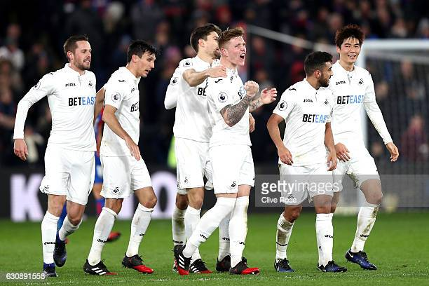 Alfie Mawson of Swansea City celebrates scoring the opening goal with his team mates during the Premier League match between Crystal Palace and...