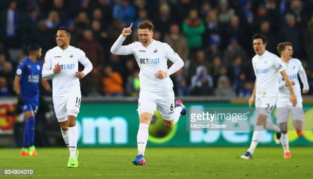 Alfie Mawson of Swansea City celebrates with team mates as he scores their first goal during the Premier League match between Swansea City and...