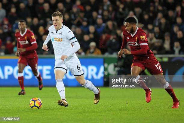 Alfie Mawson of Swansea City chased by Joe Gomez of Liverpool during the Premier League match between Swansea City and Liverpool at The Liberty...