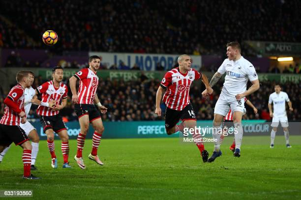 Alfie Mawson of Swansea City heads to score the opening goal during the Premier League match between Swansea City and Southampton at Liberty Stadium...