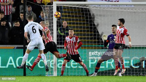 Alfie Mawson of Swansea City heads to scorethe opening goal during the Premier League match between Swansea City and Southampton at Liberty Stadium...