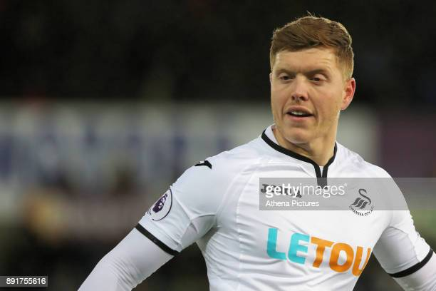 Alfie Mawson of Swansea City in action during the Premier League match between Swansea City and Manchester City at The Liberty Stadium on December 13...