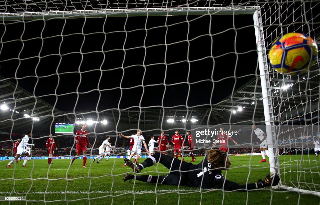 Alfie Mawson of Swansea City scores his side's first goal past Loris Karius of Liverpool during the Premier League match between Swansea City and Liverpool at Liberty Stadium on January 22, 2018 in Swansea, Wales.