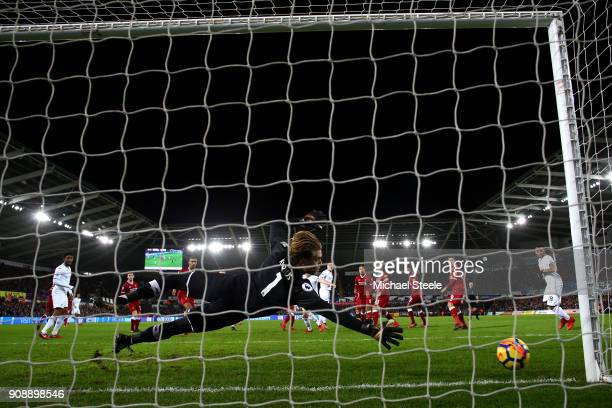 Alfie Mawson of Swansea City scores his side's first goal past Loris Karius of Liverpool during the Premier League match between Swansea City and...