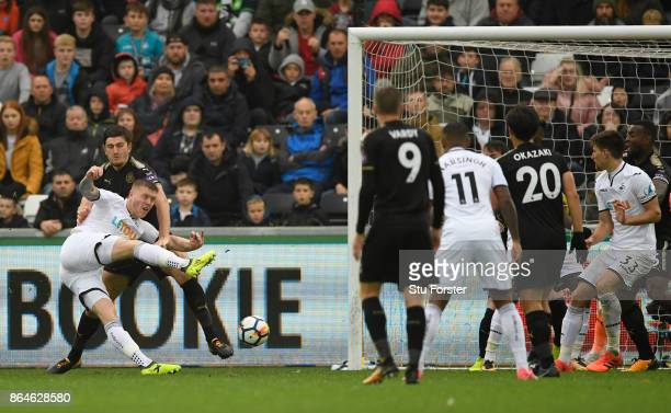 Alfie Mawson of Swansea City scores the 1st Swansea goal during the Premier League match between Swansea City and Leicester City at Liberty Stadium...