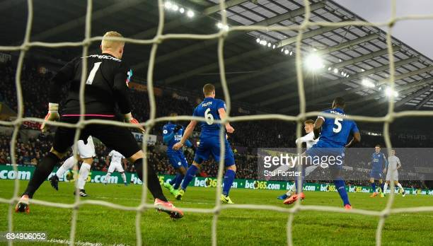 Alfie Mawson of Swansea City shoots to score the first Swansea goal during the Premier League match between Swansea City and Leicester City at...