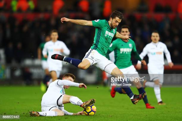 Alfie Mawson of Swansea City tackles Jay Rodriguez of West Bromwich Albion during the Premier League match between Swansea City and West Bromwich...