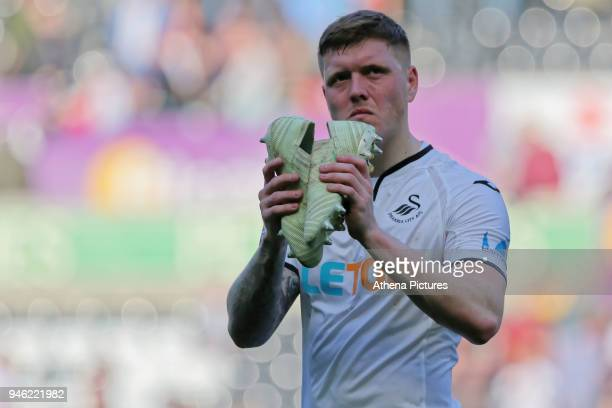 Alfie Mawson of Swansea City thanks home supporters during the Premier League match between Swansea City and Everton at The Liberty Stadium on April...
