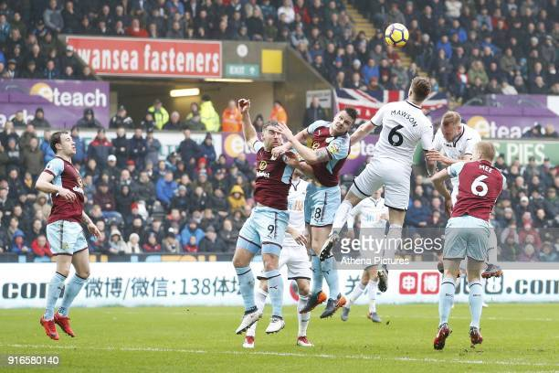 Alfie Mawson of Swansea City wins a header during the Premier League match between Swansea City and Burnley at the Liberty Stadium on February 10...