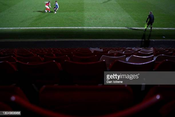 Alfie May of Cheltenham Town battles for the ball with Tom Clifford of Southend United during the Sky Bet League Two match between Cheltenham Town...