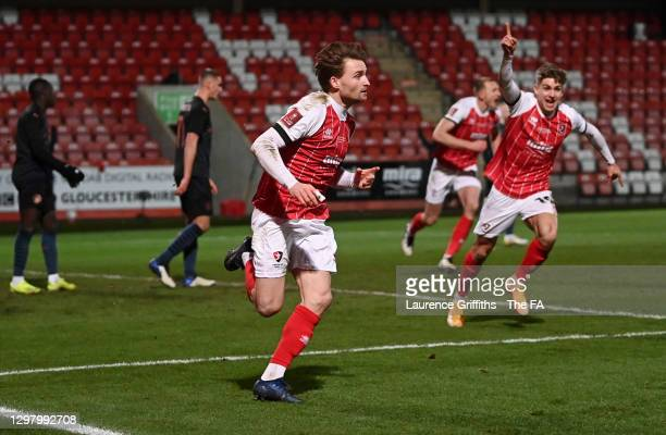 Alfie May of Cheltenham Town celebrates after scoring their side's first goal during The Emirates FA Cup Fourth Round match between Cheltenham Town...