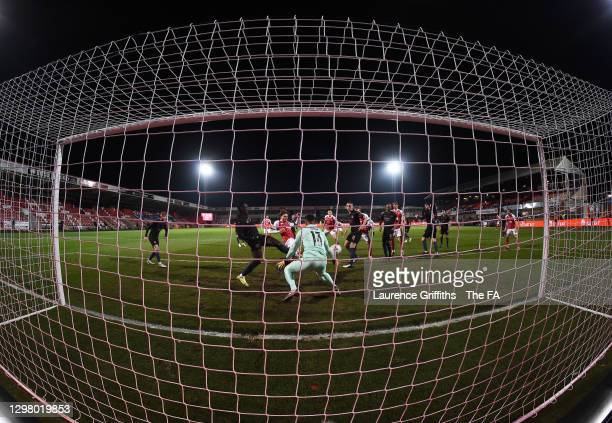 Alfie May of Cheltenham Town scores their team's first goal past Zack Steffen of Manchester City at Jonny Rocks Stadium on January 23, 2021 in...