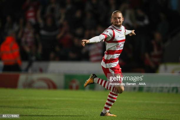 Alfie May of Doncaster Rovers celebrates after scoring a goal to make it 10 during the Carabao Cup Second Round match between Doncaster Rovers and...