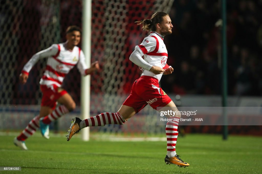 Alfie May of Doncaster Rovers celebrates after scoring a goal to make it 1-0 during the Carabao Cup Second Round match between Doncaster Rovers and Hull City at Keepmoat Stadium on August 22, 2017 in Doncaster, England.