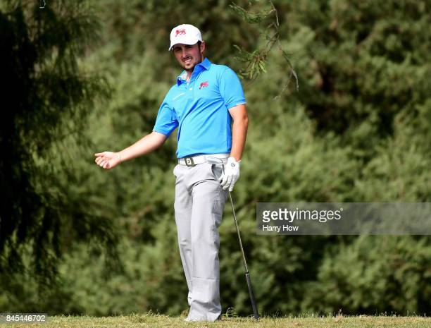 Alfie Plant of Team Great Britain and Ireland reacts to his chip out of the rough on the seventh hole losing to Maverick McNealy of Team USA four and...