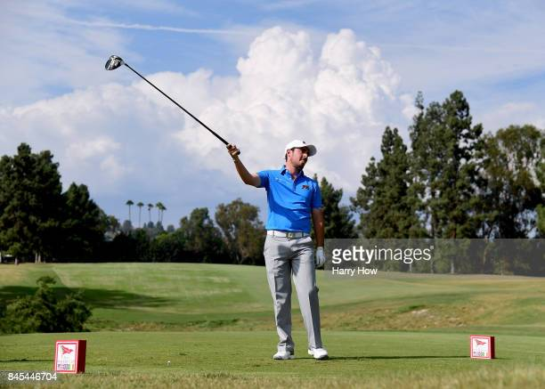 Alfie Plant of Team Great Britain and Ireland reacts to his drive on the eighth hole losing to Maverick McNealy of Team USA four and two during the...