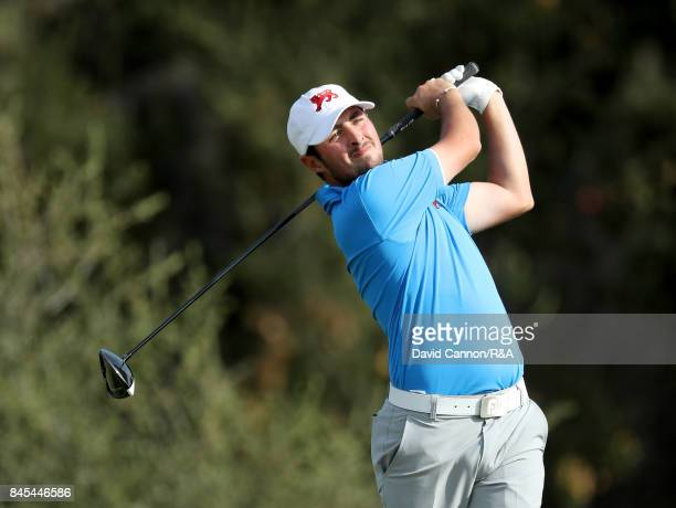 Alfie Plant of the Great Britain and Ireland team plays his tee shot on the 12th hole in his match against Maverick McNealy of the United States team...