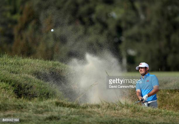 Alfie Plant of the Great Britain and Ireland team plays his third shot on the 12th hole in his match against Maverick McNealy of the United States...
