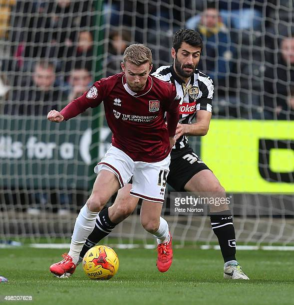 Alfie Potter of Northampton Town controls the ball uder pressure from Mike Edwards of Notts County during the Sky Bet League Two match between Notts...