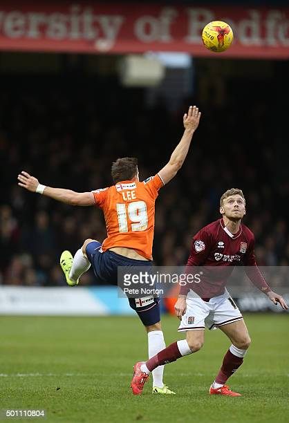 Alfie Potter of Northampton Town looks to the ball with Olly Lee of Luton Town during the Sky Bet League Two match between Luton Town and Northampton...