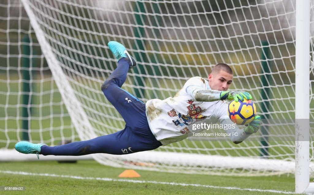 Alfie Whiteman of Tottenham Hotspur trains in a Chinese New Year t-shirt ahead of the north london derby during the Tottenham Hotspur training session at Tottenham Hotspur Training Centre on February 9, 2018 in Enfield, England.