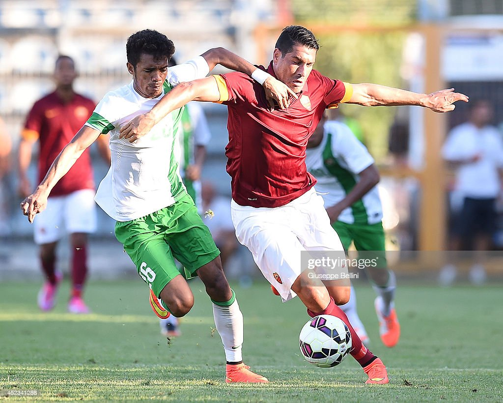 Alfin Tuasalamony of Indonesia U21 and Marco Borriello of Roma in action during the friendly match between AS Roma and Indonesia U23 at Stadio Centro d'Italia - Manlio Scopigno on July 18, 2014 in Rieti, Italy.