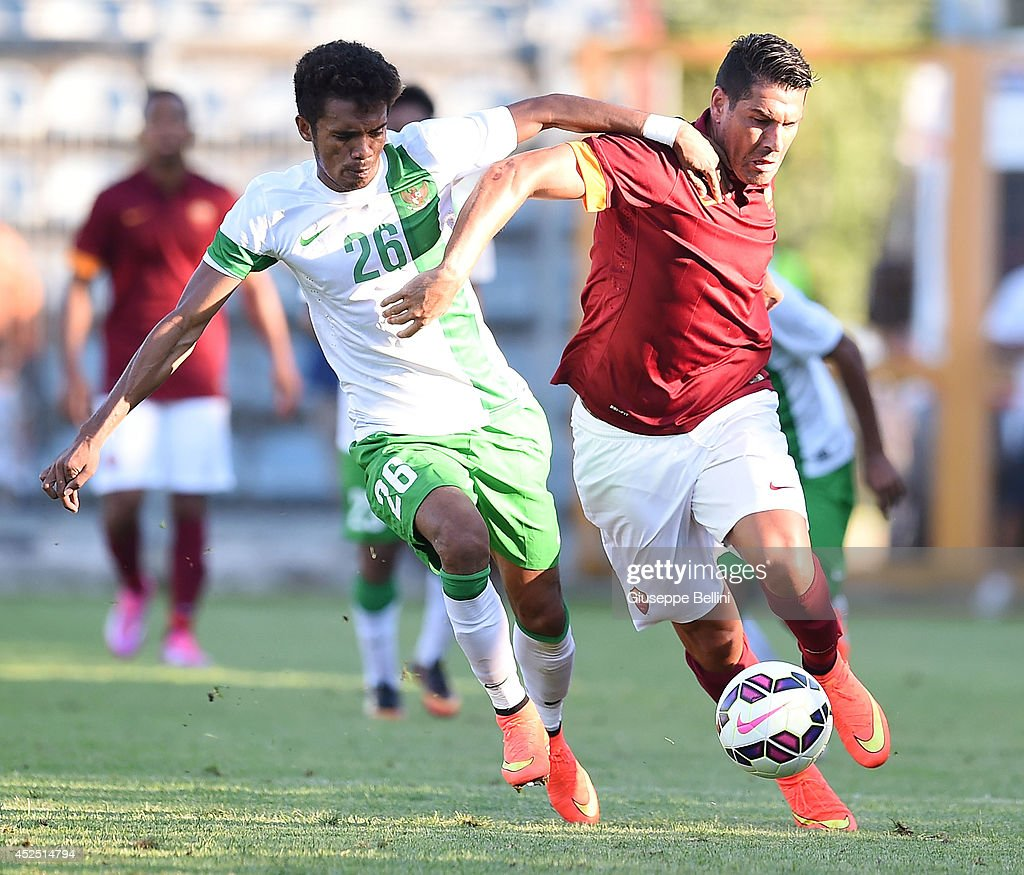 Alfin Tuasalamony of Indonesia U23 and Marco Borriello of Roma in action during the friendly match between AS Roma and Indonesia U23 at Stadio Centro d'Italia - Manlio Scopigno on July 18, 2014 in Rieti, Italy.