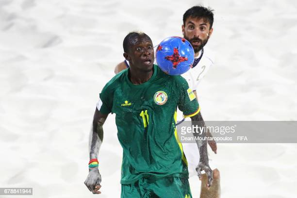Alfioluca Chiavaro of Italy battles for the ball with Ibrahima Balde of Senegal during the FIFA Beach Soccer World Cup Bahamas 2017 quarter final...