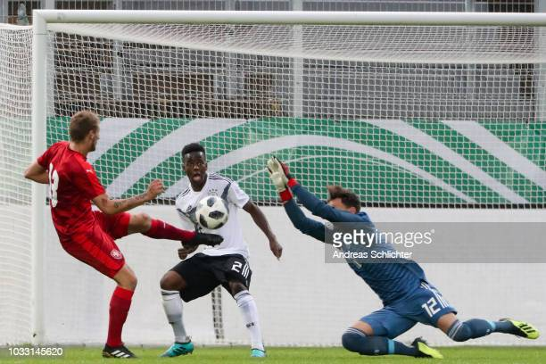 Alfons Amade , Constantin Fromman of U20 Germany challenges Martin Rychnovsky of Czech Republic during the U20 friendly match between Germany and...