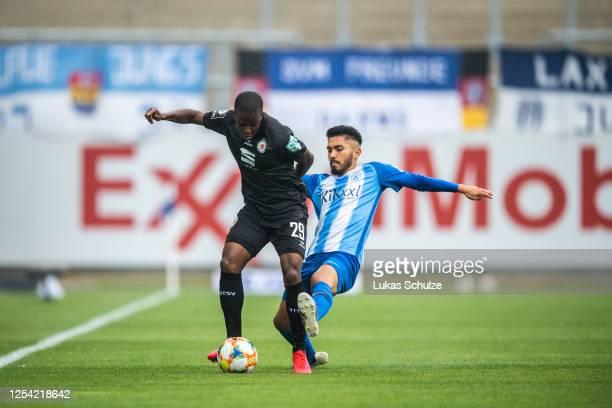 Alfons Amade of Braunschweig challenges for the ball with Hassan Amin of Meppen during the 3 Liga match between SV Meppen and Eintracht Braunschweig...